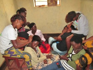 Abasangirangendo women learning how to do hair