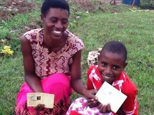 """""""This card is an important asset we keep in our family. Any time we see it, we feel we don't worry about our future as far as our health is concerned. I cannot thank our donors enough, but I only pray for a blessing upon them."""" Alphonsine Nirere - Joy Cooperative"""