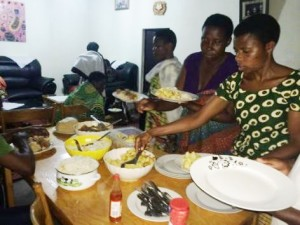 Having dinner together at our home. They brought with cassava flour and this supplemented any food which was available.