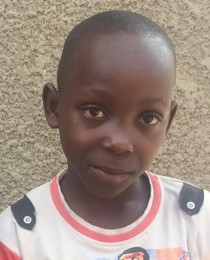 Samuel Nzayisaba is a 9 year-old boy, one of the new orphans at Ejo Habo orphanage.