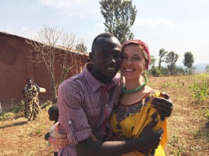 "KATRINA NELSON: ""We'd been sitting under the giant tree of the church service for several hours when two young adults from Imbereheza stepped up. One I recognized as Juliette. The second I recognized, too. 'My name is David,' he said in Rwandan. My Student! This was my student! 'I'm Katrina!' I exclaimed. 'I know!' he answered, with the biggest smile on his face. I'd never experienced anything like this before - it was like meeting long-lost family. A simple task I'd taken on now was my contribution to the world; we both were transformed by a couple of dollars and a couple of letters."""