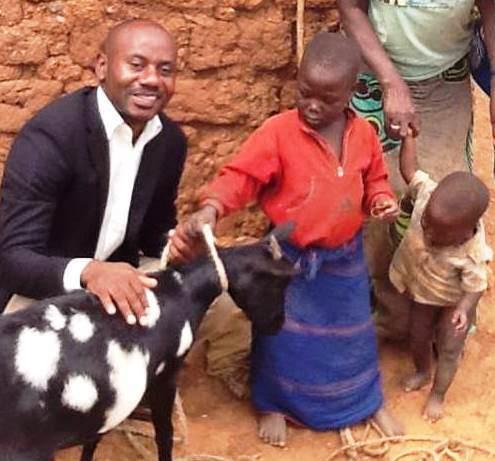 ! Justin with Tubehot Mukabirasa Madelline, goat 2 c