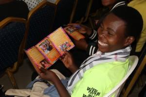 Peninah reading the WD4H brochure