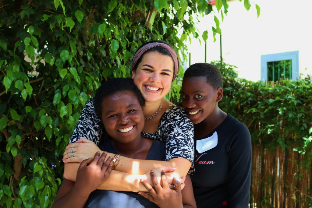 Every student has a sponsor - here is Genevieve with her arms around her student, Winy.