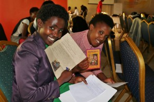 Felicite and Kampire reading sponsor letter and brochure