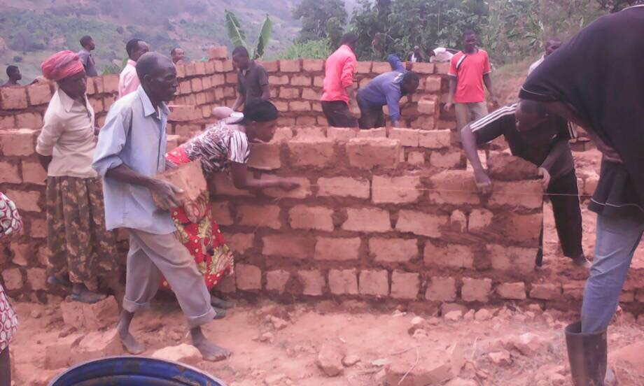 Our donation to Umunezero enabled the community to build a house for a blind couple and their children.